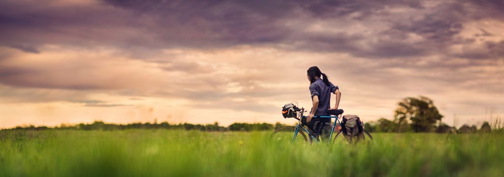 Self Portrait of Anthony Chang in a field with bicycle