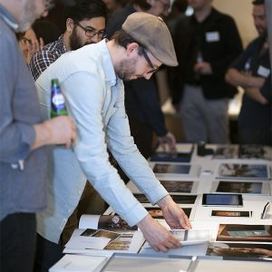 Contact Festival Portfolio Review man looking at entries 2