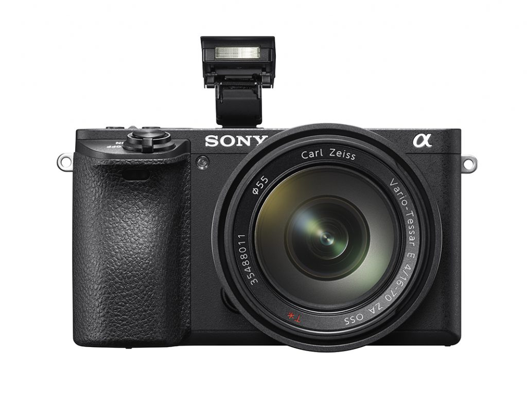 Sony α6500 front view with flash