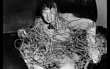 Man tangled in cables