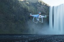 Phantom 4 Pro v2 hovering above waterfall