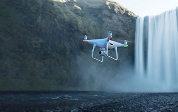 Phantom 4 Pro v2 hovering above waterfall