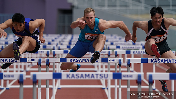 Men jumping hurdles shot with Sony FE 200-600mm lens