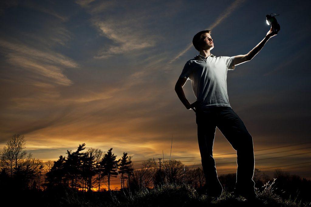 man holding flash