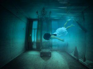 Woman in dreamy underwater scene