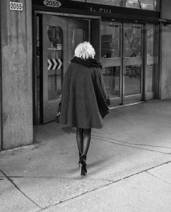Woman Walking in Street by Rudi Rincker